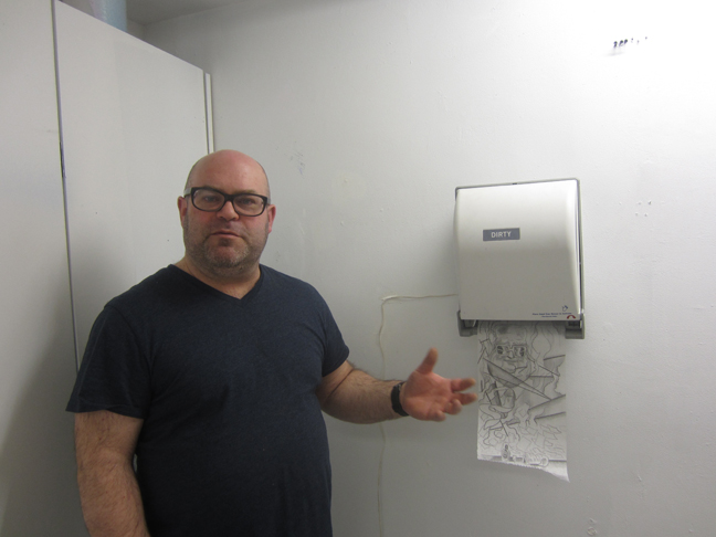 Daniel-Davidson-w-his-paper-dispenser