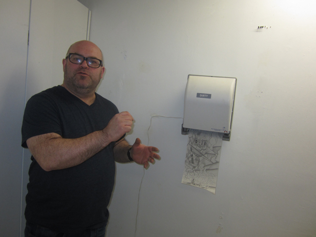 Daniel-davidson-with-his-paper-dispenser